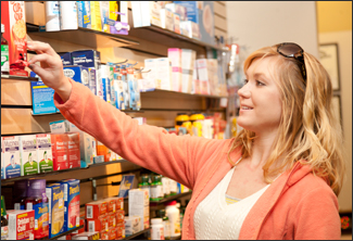 Student browses some of the many non-prescription items stocked by the UHC Pharmacy